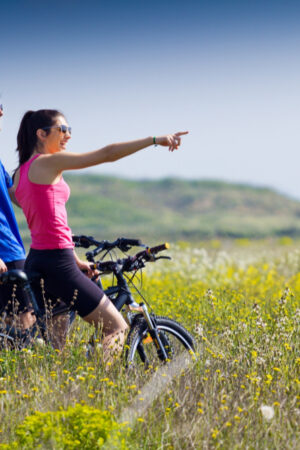 happy-young-couple-bike-ride-countryside
